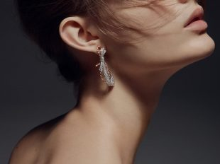 Chaumet's Insolence earrings (large version) feature lightly tied knots that dangle provocatively from the lobe and sparkle with two brilliant-cut diamonds